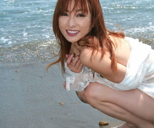 Japanese girl with reddish hair exposes small hooters and..