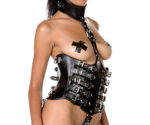 Solo model Chems shows her boobs and twat in fetish wear..