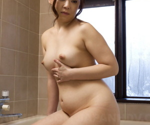 Chubby Japanese woman An Kanoh has help from a man in..
