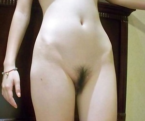 Lovely selection of an asian honey showing her bushy cunt..