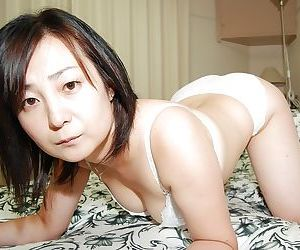 Lusty Japanese MILF peels off down and has some beaver..