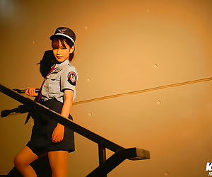 Small asian girl in uniform leisurely uncovering her..