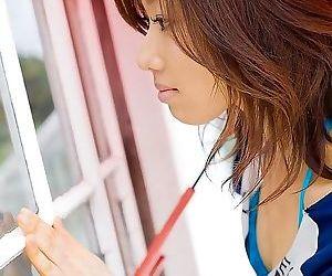 Japanese babe jun kiyomi shows hooters poses outdoors -..