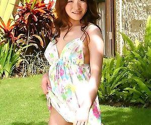 Asian beauty yui kurata posing outdoors shows body - part..
