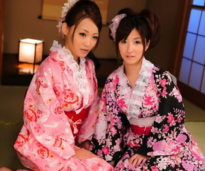 A pair of Japanese Geishas model together in their..