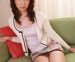 Japanese redhead Yoshioka Nanako glides off her undies..