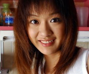 Adorable Japanese teenage Izumi hesitantly exposes her..