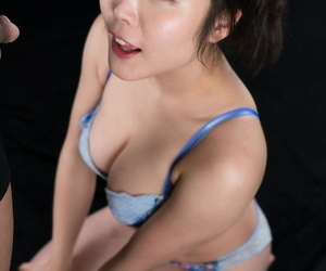 Japanese lady in her bra and g-string ensemble eats cum..