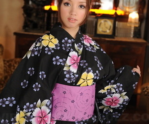 Japanese teen with a pretty face models non nude in floral..