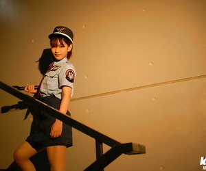 Diminutive asian chick in uniform leisurely exposing her..