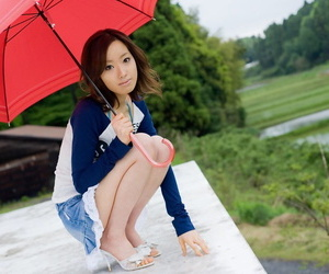 Adorable Japanese teenager bares her flat pecs prior to..