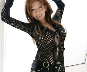 Japanese girl with a ample arse pins her nipples while..