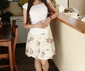 Japanese sweetie Shiho Miyasaki hoists her micro-skirt up..