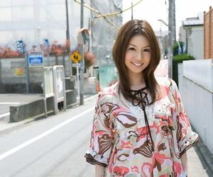 Young Japanese girl Tatsumi Yui hits great poses in..
