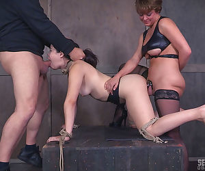 Tattooed BDSM babe Yhivi gets the strapon while..