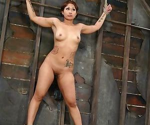 Naked Asian female DragonLily endures caning and nipple..
