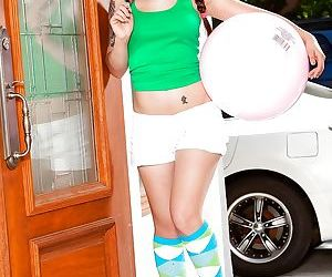 Asian teen Mika Sparx in pigtails & knee socks showing..
