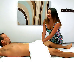 Asian masseuse lends a hand and takes the cock to give..