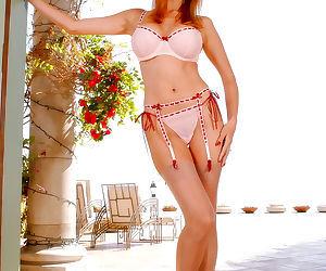 MILF pornstar Tera Patrick doffs sexy underwear to reveal..
