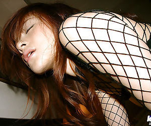 Horny asian babe Sumire Aida posing in BDSM outfit and..