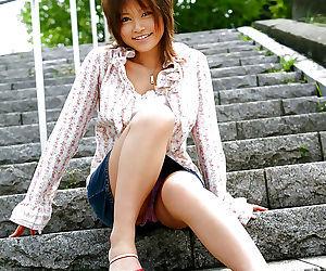 Sexy asian coed Hitomi Yoshino flashing her bush and..