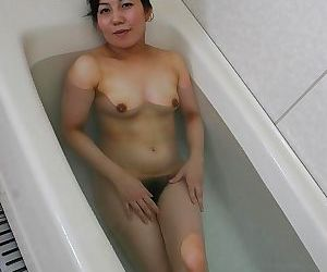 Fuckable asian mature lassie taking bath and exposing her..