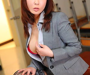 Busty Asian office lady Kyoushi Kan flashes her panties..