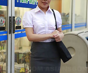 Beautiful Japanese woman Ai Yoneyama posing in public in..