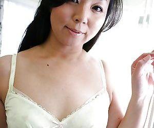 Playful MILF Takako Nishazawa revealing her small tits..