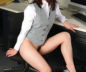 Japanese office lady Arisa Suzuki gets sandwiched by her..