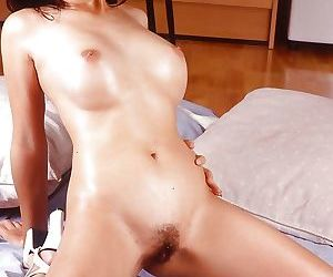 Asian babe with big tits and hairy pussy masturbates in..
