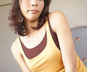 Hot to trot tranny from Asia knows how to pose on cam..
