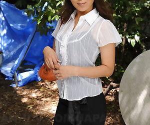 Sexy Asian Erika Hiramatsu squats in short skirt and high..