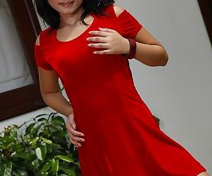 Pretty Asian girl Kuk Kik removes her red dress to pose..