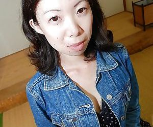 Shy asian MILF strips down and has some pussy fingering..
