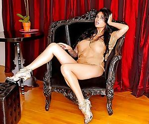 Busty Asian babe Tera Patrick displaying sexy MILF legs in..