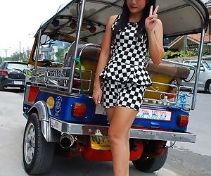 Cut Thai girl with a pleasing face poses for candid shots..