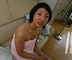 Frisky asian MILF Emi Ishibashi showcasing her seductive..