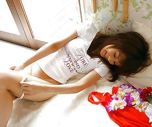 Ravishing asian teen babe with sexy legs showcasing her..