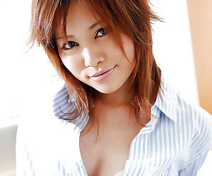 Naughty asian coed Hitomi Yoshino showcasing her jugs and..
