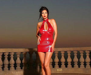 Sexy Asian pornstar Tera Patrick posing in latex dress &..