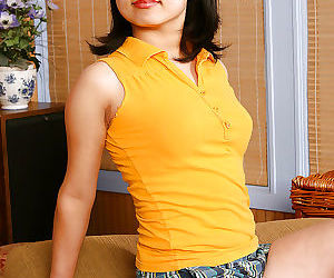 Petite Asian chick Mini undressing and baring small..