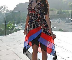 Asian Milf babe Kalina Ryu posing outdoors fully clothed..