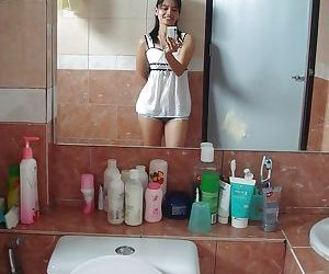 Petite Thai girl tales self shots before stripping naked..