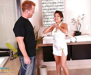 Busty asian masseuse has some oily cock jerking and..
