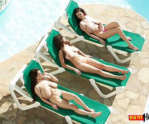 3 big boobed females go topless while soaking up some rays..