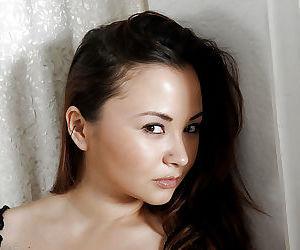 Cute Oriental amateur Kita Zen pulling thong panties down..
