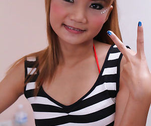 Beautiful tiny Asian Pim spreading naked on the bed..