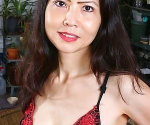 Mature asian babe emmeline johnson toying her tight twat...
