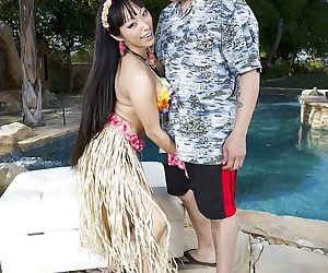 Busty Asian MILF Gaia blowing a white dude beside swimming..